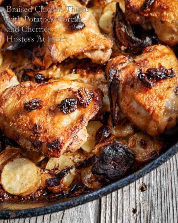 Braised Chicken Thighs with Potatoes, Porcini & Dried cherries is cradled in a creamy garlic sauce that makes a complete, delicious meal | Hostess At Heart