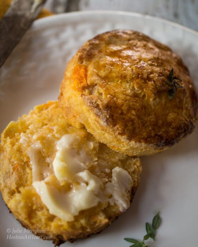 Herb-Topped Sweet Potato Biscuits are an easy delicious biscuit that combines the sweetness of the sweet potato with the savory herb. These biscuits are flaky and buttery with a nice little zing from cayenne pepper. | Hostess At Heart