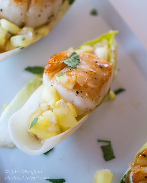 Scallops with Pineapple Salsa and Plum Wasabi Drizzle | Scallops with Pineapple Salsa and Plum Wasabi Drizzle make an impressive appetizer. No one needs to know how quick and easy it is to make | HostessAtHeart.com