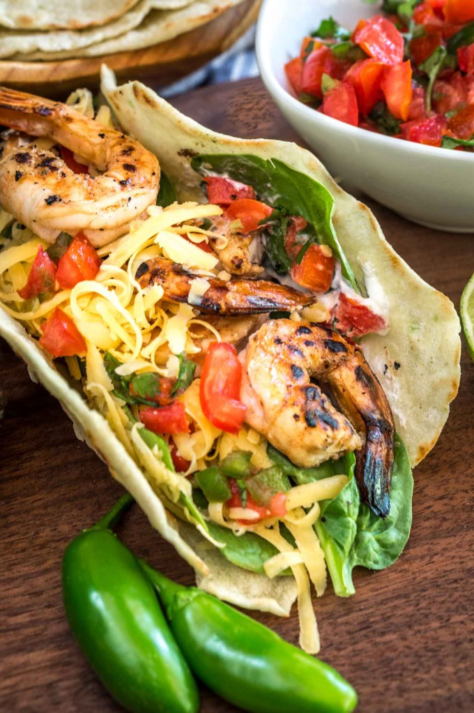 These Raspberry Jalapeno Shrimp Tacos are quick, easy, and absolutely delicious. There's a hint of sweet followed by a little heat. Best of all, they're easy on the waistline | HostessAtHeart.com