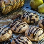 Pear Hand Pies with Dark Chocolate Drizzle are packed with pears that have been baked in a sauce of brown sugar and cinnamon between a flaky buttery crust. The drizzle of dark chocolate gives this pie a deeper richness.   HostessAtHeart.com