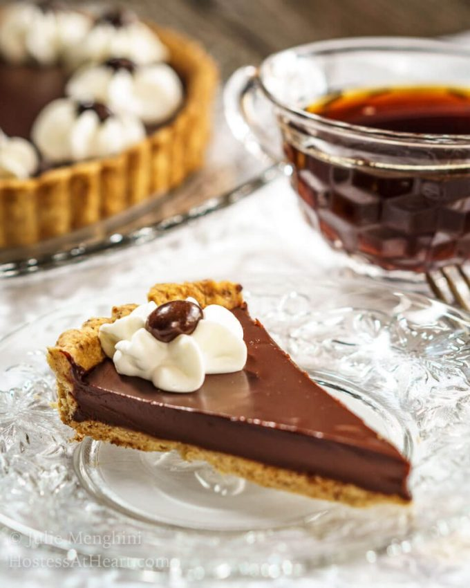 This Dark Chocolate Pecan Tart is fancy enough to impress but quick and easy enough to make any time for that very special someone. | HostessAtHeart.com