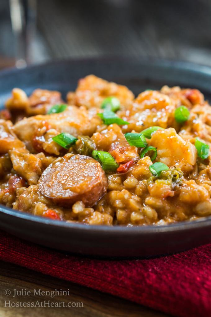 Whether you're celebrating Mardi Gras with one, two or a few, this is The Best Slow Cooker Jambalaya with Farro recipe.   HostessAtHeart.com