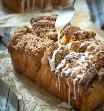 Apple Pecan Streusel Pull Apart Bread makes a delicious addition to your breakfast or with a cup of soup. It's a no-fuss way to get the taste of a cinnamon roll without all of the work.   HostessAtHeart.com