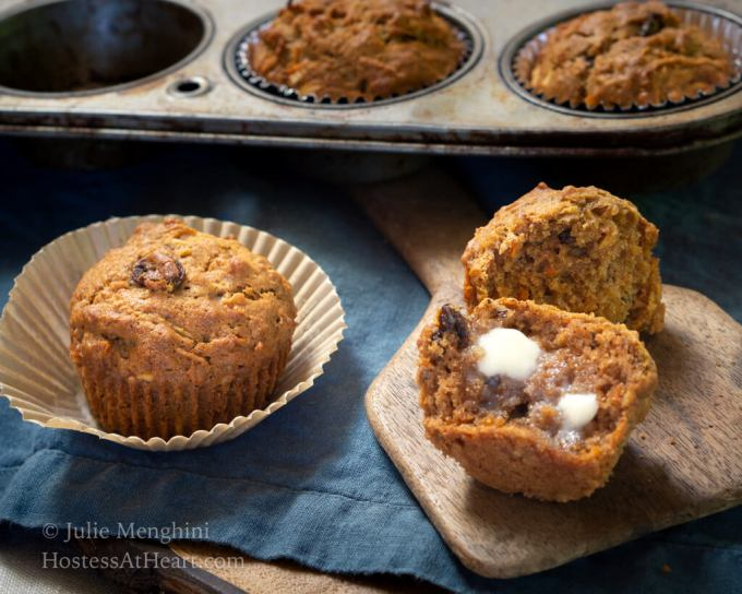 Horizontal view of whole muffin, split muffin and filled muffin tin