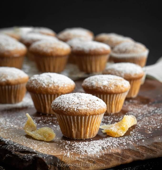 Sugar dusted mini muffins on a wood cutting board