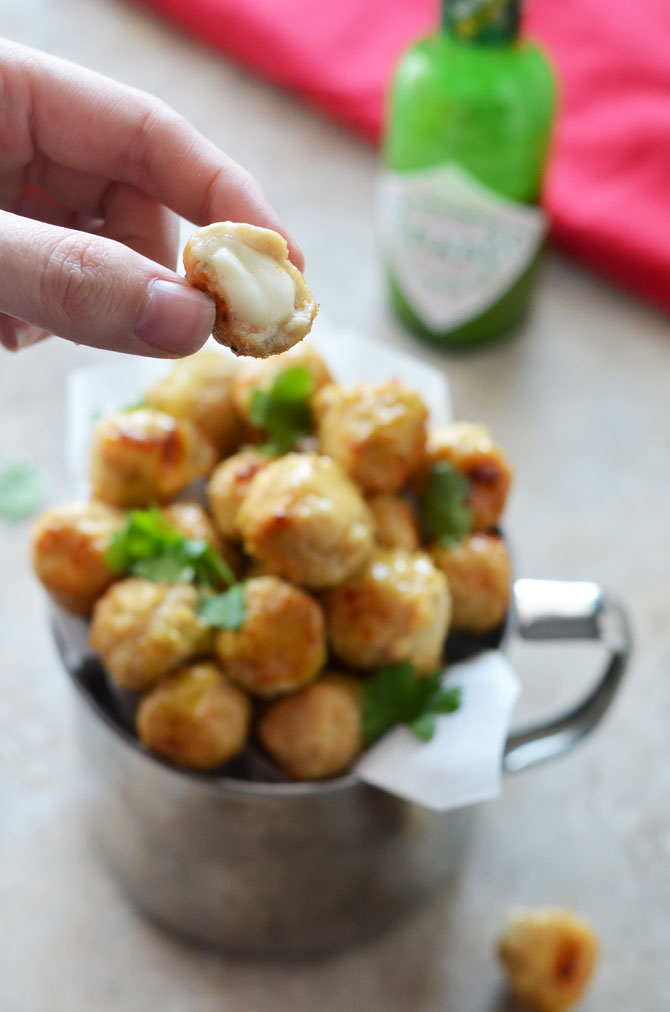 Jalapeno Honey Glazed Cheesy Chicken Poppers. These itty bitty chicken meatballs are stuffed with mozzarella and brushed with sweet and spicy glaze for an awesome appetizer! | hostthetoast.com