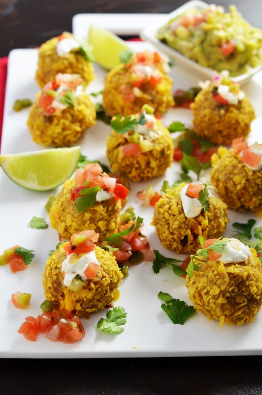Loaded Nacho Bombs. All of the best nacho flavors in bite-sized balls. Perfect for a Super Bowl party or pot luck!   hostthetoast.com