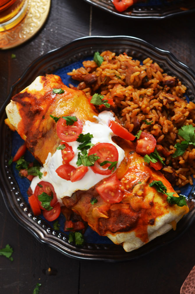Slow Cooker Smothered Beef Burritos. These flavor-packed Tex-Mex burritos feature crock pot shredded beef and a seriously delicious tomato-chili gravy! | hostthetoast.com