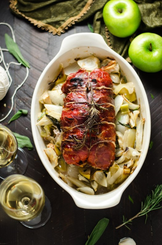 Prosciutto-Wrapped Pork Loin with Apple & Rice Stuffing. This all-in-one holiday meal is going to be a family favorite-- and is much easier to make than you'd imagine! | hostthetoast.com