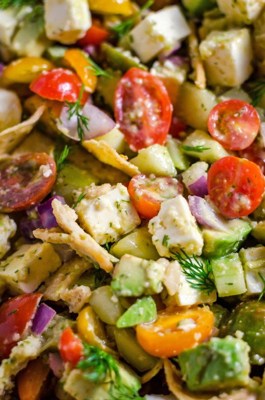 Greek Avocado Salad with Garlic-Dill Vinaigrette. This simple salad takes just minutes to put together and requires no cooking, but packs in a ton of diverse flavors and textures to make it a must-have side dish for the warm-weather months! | hostthetoast.com