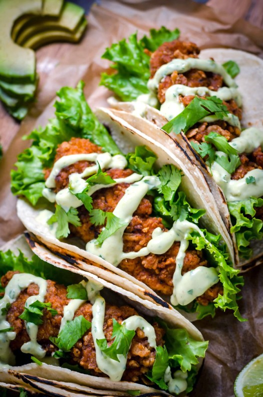 Crispy Chicken Tacos with Avocado Buttermilk Ranch. These tacos aren't traditional by any means, but they ARE delicious. Crispy, Mexican-seasoned chicken tenders + cool, creamy avocado ranch sauce are a match made in taco heaven.   hostthetoast.com