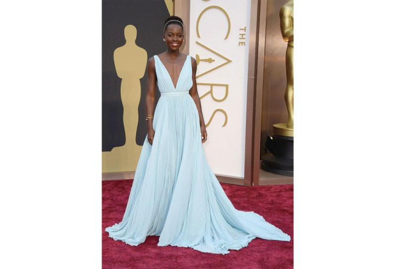 http://www.eonline.com/news/516472/lupita-nyong-o-wears-prada-to-the-2014-oscars-it-s-a-blue-that-reminds-me-of-nairobi