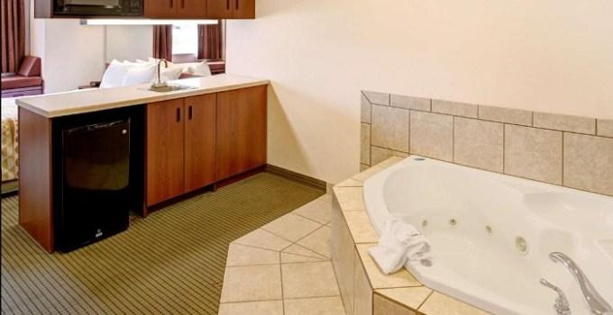Studio with a whirlpool tub in the room in Microtel Inn & Suites by Wyndham Bellevue, Omaha, Nebraska