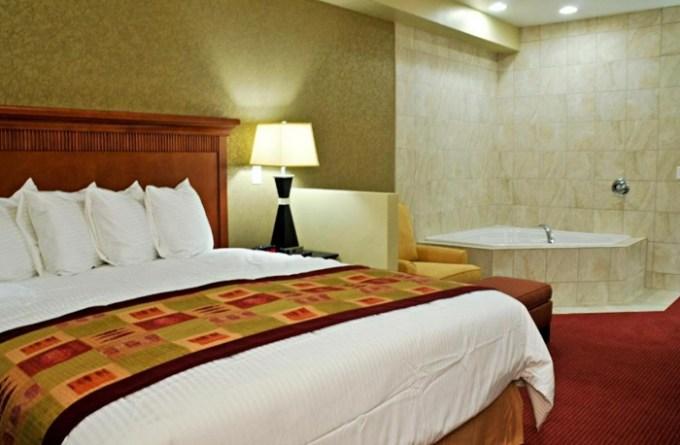 Suite with a whirlpool tub in the bedroom in Best Western Plus Layton Park Hotel, Utah