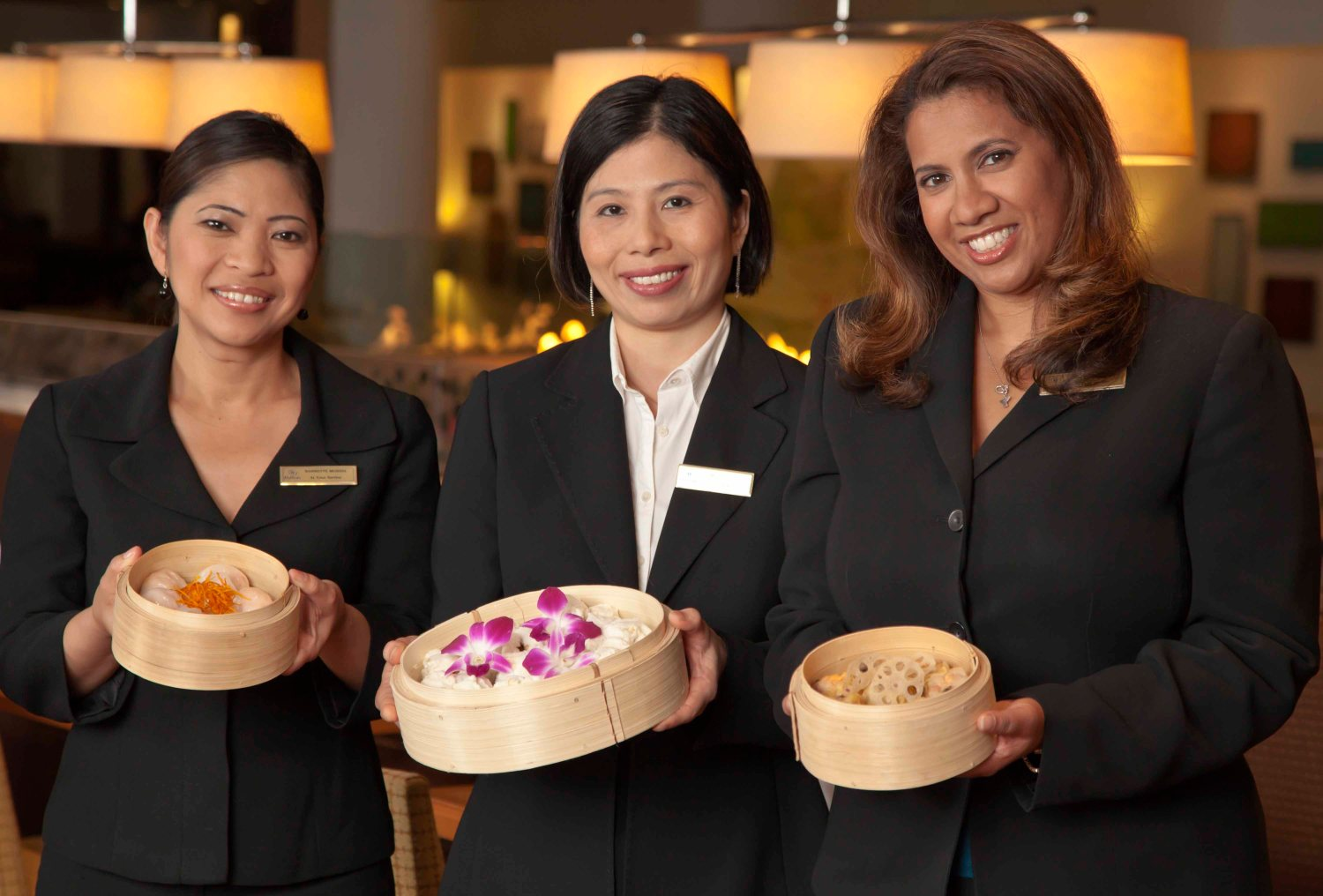 Employees/ Hostesses Hilton Hotel Holding examples of Chinese breakfast