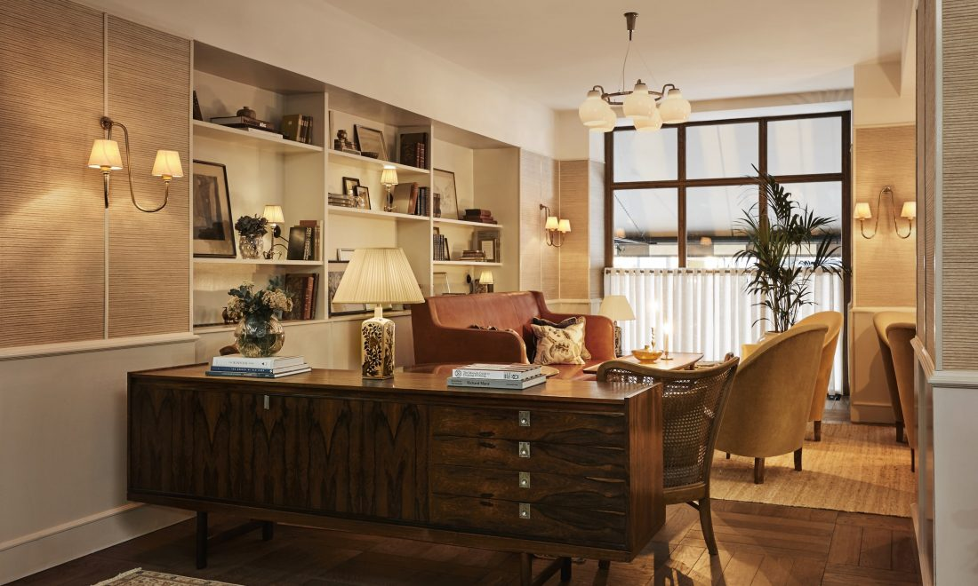 hotel with living room blue gray and yellow sanders the is equipped an open fireplace brimming bookshelves vintage bespoke furniture appealing seating arrangements