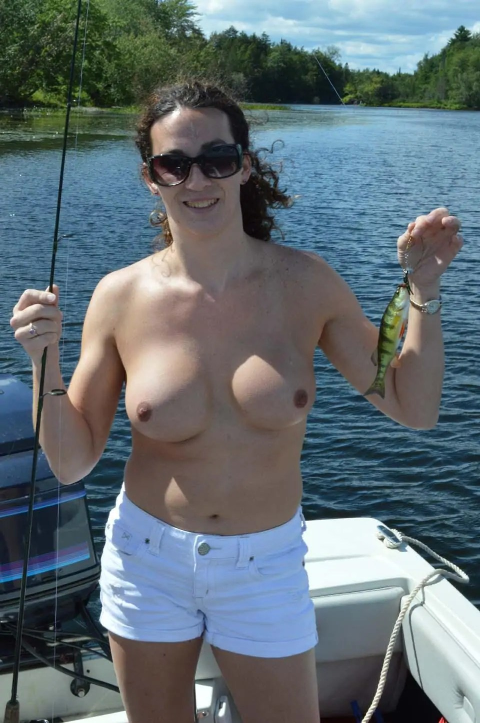 Girl fishing naked on boat