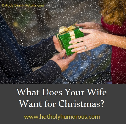 Husband and Wife holding Christmas gift