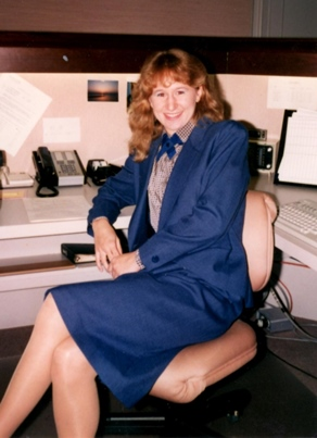 J. Parker sitting at office cubicle in law firm where she worked after college
