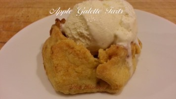 Ice cream melting over the top of a warm, fresh, apple galette tart.