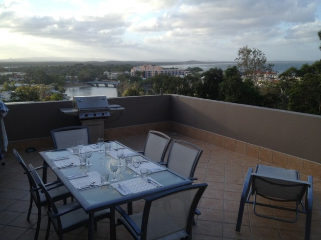 Outdoor table all set for our dinner with Maureen and John
