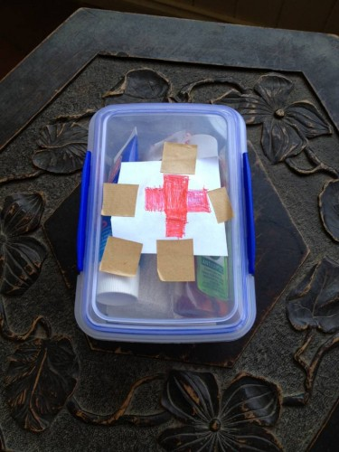 Alfie's hand-made first aid kit.  It even has a red cross!