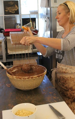 Rebecca making hollow molds for salted caramel chocolates