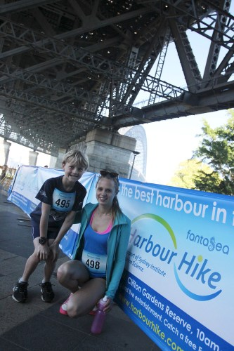 Two keen participants waiting under the Harbour Bridge