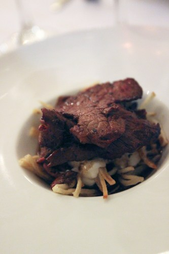 Marinated beef fillet with shoestring fries, garlic yoghurt and jus