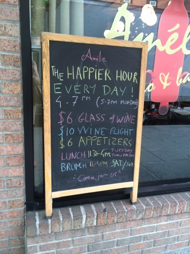 A blackboard advertising the Happy Hours