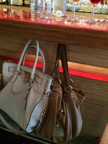 I love how there are hooks under the bar to hang your 'oversized, overpriced designer handbag'