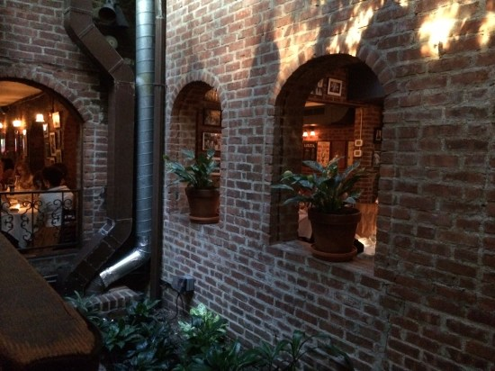 Through the archways you can see the courtyard with trees covered in fairy lights