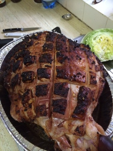 Glazed ham resting after coming out of the oven
