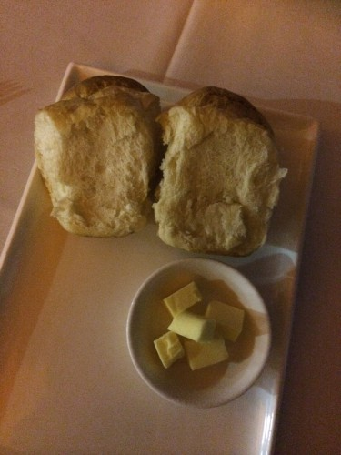 Warm bread rolls with butter