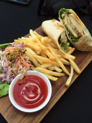 Poolside chicken sandwich with fries and salad