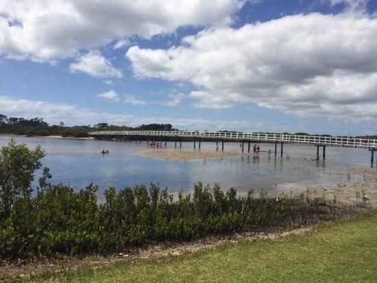 Walk across the bridge to the beach