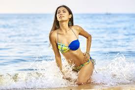 tan girl in bikini at beach
