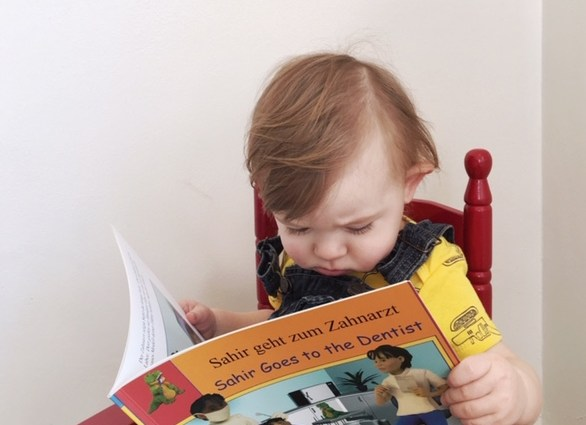 Reading a book from Language Lizard