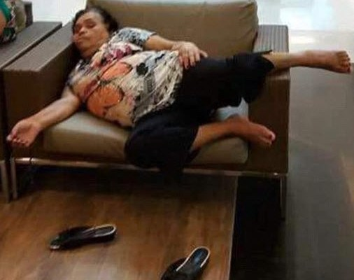 Woman falls asleep at the shopping mall
