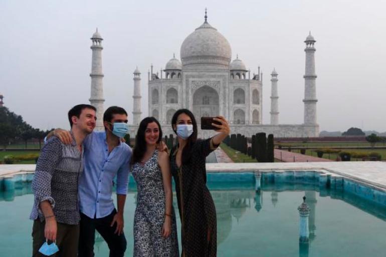 撑不住了?疫情重创印度经济,日增两万病例还邀全球人来旅游