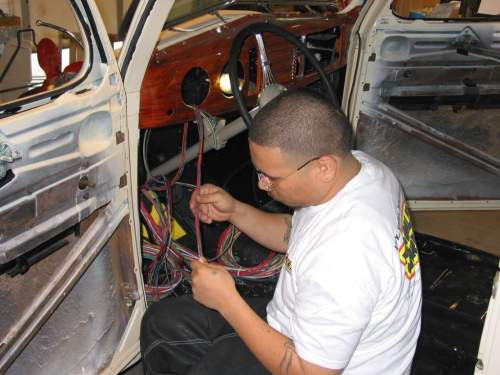 small resolution of sergio now starts separating the different groups of wires in the harness the three main groups are for the dash engine compartment and the tail of the