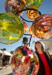 Mila Minic-Massey, of Tampa, Fla., checks out blown glass artwork Nov. 9, 2012 during Festival of the Masters at Downtown Disney. Festival of the Masters presented by Michaels features artistic creations from more than 130 award-winning artists, more than 20 up-and-coming Emerging Masters, the Disney Artist Village, live performance artists and more. The annual event takes place at Downtown Disney at Walt Disney World Resort in Lake Buena Vista, Fla. Nov. 8-10, 2013 and there is no charge for admission. (Kent Phillips, photographer) - See more at: http://wdwnews.com/galleries/2012/10/22/festival-of-the-masters/#photo-4