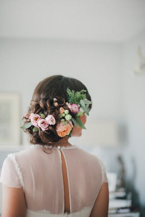 Curly Updo with Pastel Flowers