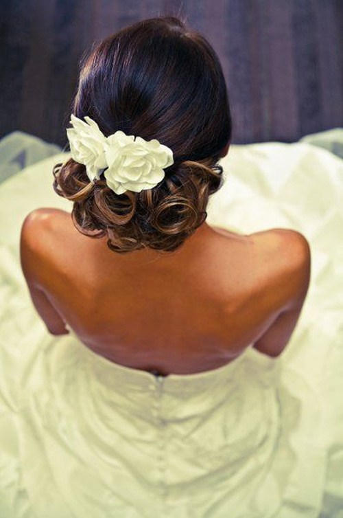 Low Updo with Flowers and Chic Ringlets