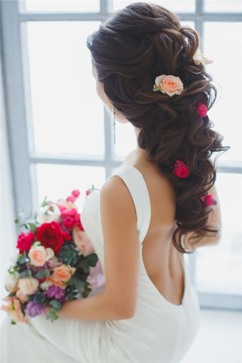 Wavy Bridal Hairstyle with Red Flower
