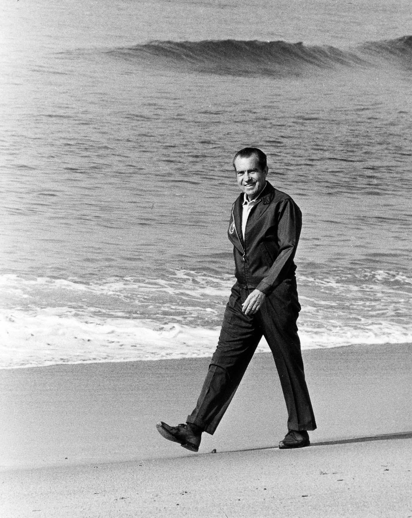 Richard Nixon walking on beach