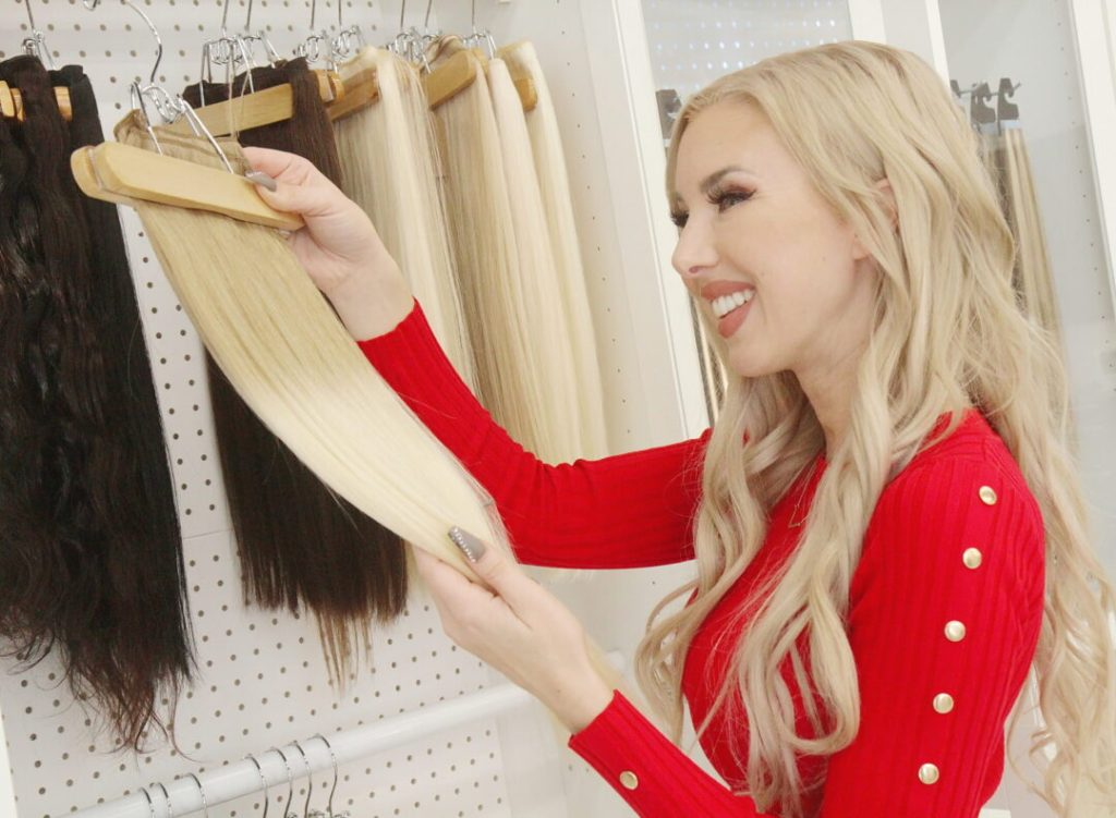 Hair Stylist Looking at Weft Hair Extensions in Las Vegas