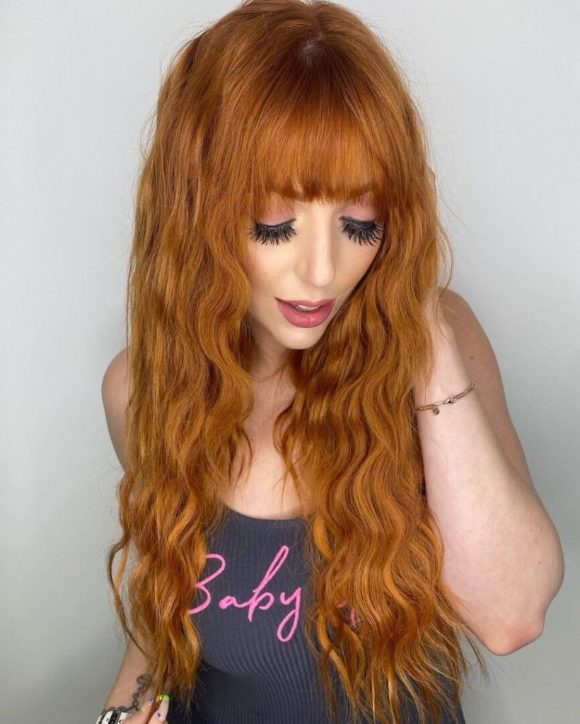 22 Inch Ginger Tape In Virgin Russian Hair Extensions Installed On Women