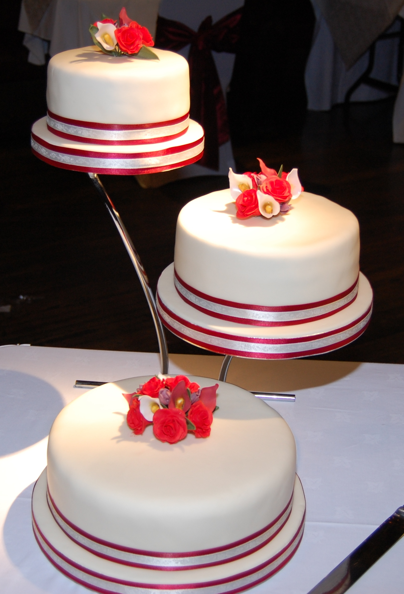 3 Tier Wedding Cake With Roses And Calla Lilies